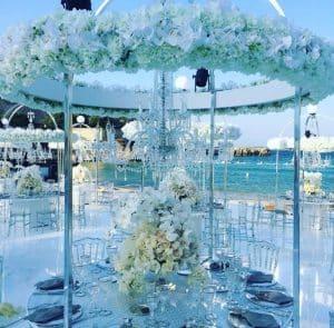 Renee Sutton wedding in Monopoli with chandeliers on the beach wedding
